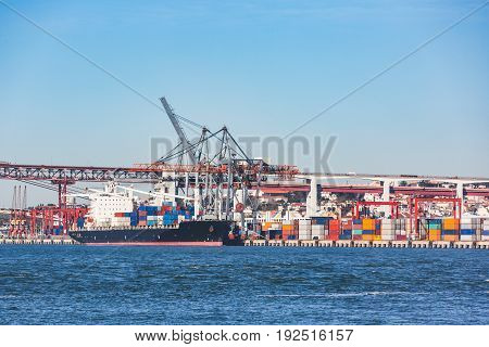 Cargo Ship Loading Containers In Lisbon Port