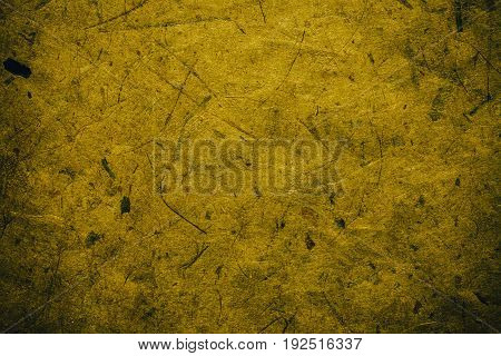 Yellow vintage background. Rough yellow texture and background for designers. Close up view of abstract dark yellow texture made with recycle paper. Plant fiber background.