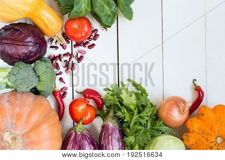 variety of colorful vegetables on white painted wooden table. top view