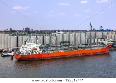 Rotterdam, Netherlands - May 20, 2017: Tanker port terminal and cargo ship Rotterdam Netherlands