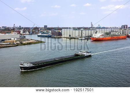 Rotterdam, Netherlands - May 30, 2017: Tanker port terminal and cargo ship in Rotterdam port, Netherlands