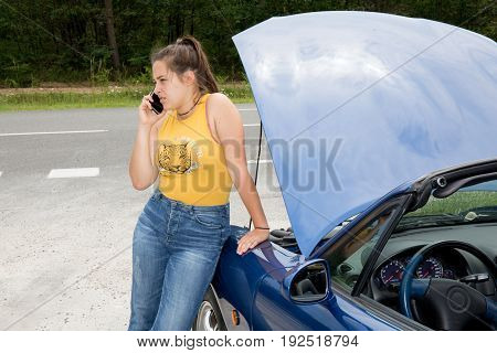 Worried Traveler Woman Calling Assistance With A Breakdown Car