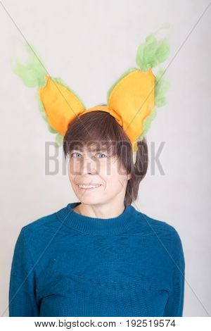 Cheerful portrait of a woman with big artificial ears
