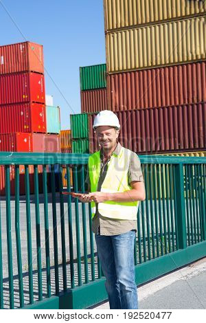 View Of A Dock Worker Supervisor Checking Containers Data