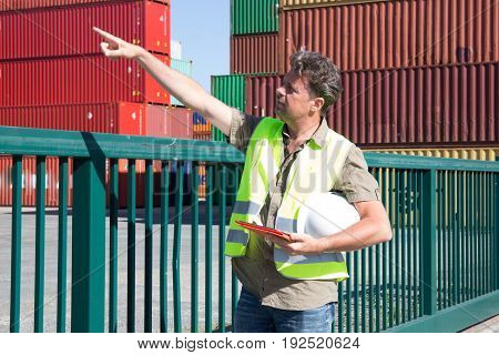 Harbor Worker With Tablet At Container Warehouse
