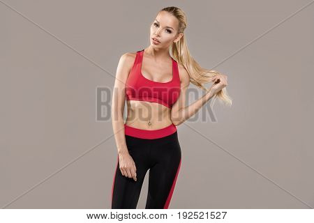 Posing fitness sexy woman in studio. Ideal fit body.