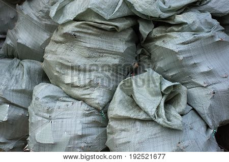 A Pile Of Sacks With Construction Debris, Carrying Out Repairs
