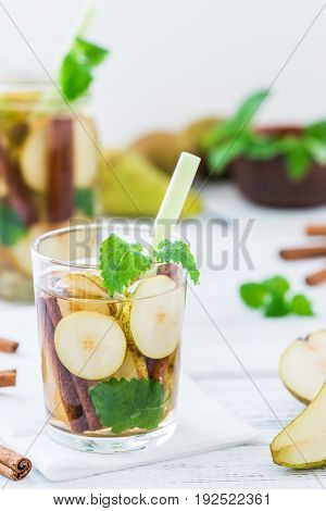 Refreshing Drink With Pear, Cinnamon On White Rustic Table