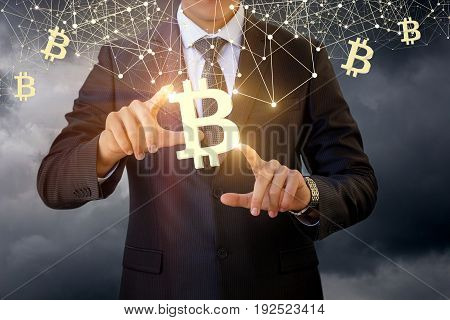 Businessman Touches Of The Bitcoin Symbol .