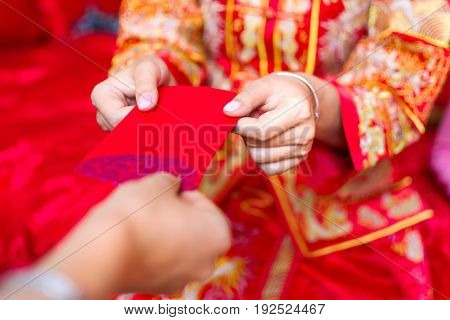 Chinese Bride Giving Red Pocket Lucky Money