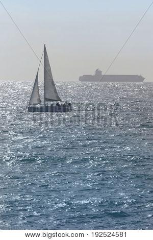 Sailboat in the waters of the Haifa Bay