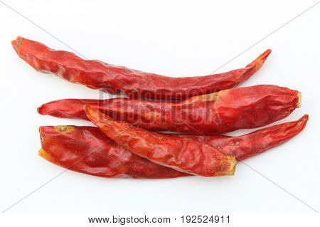 Dried red chili or chilli cayenne pepper isolated on white background.