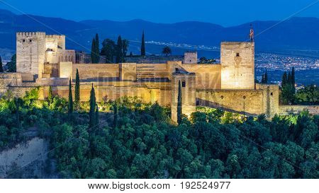 Closeup view of ancient arabic fortress of Alhambra at sunset. Granada, Spain.