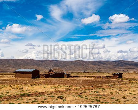 traiditional indigenous Adobe farm in el altiplano - High Plain - of Bolivia