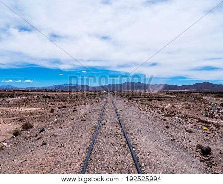 Abandoned railroad track in Uyuni bolivia near the railroad graveyard