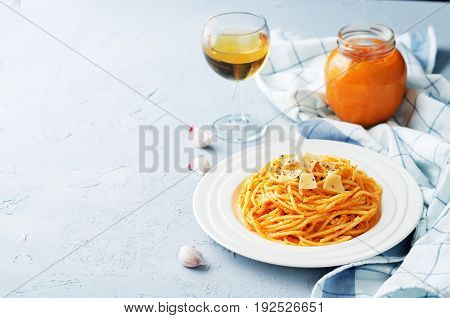 Roasted Red Bell pepper pasta on a grey background