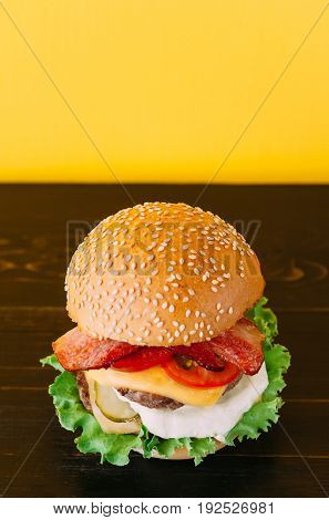 Bright Juicy Appetizing Burgers With Chops, Cheese, Marinated Cucumbers, Tomatoes And Bacon