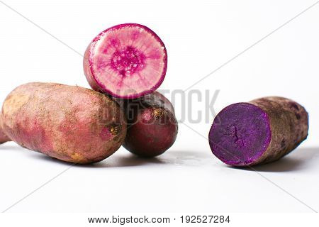 Purple Potatoes Isolated On White Background,