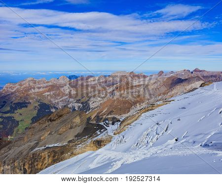 View from Mt. Titlis in the Swiss Alps in autumn. Titlis is a mountain, located on the border between the Swiss cantons of Obwalden and Bern. It is mainly accessed from the town of Engelberg on its north side.
