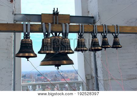 Different bells in church belltower in Kozelets town