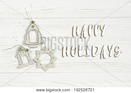 Happy Holidays Text Sign On Christmas Simple Vintage Toys On Stylish White Rustic Wooden Background.