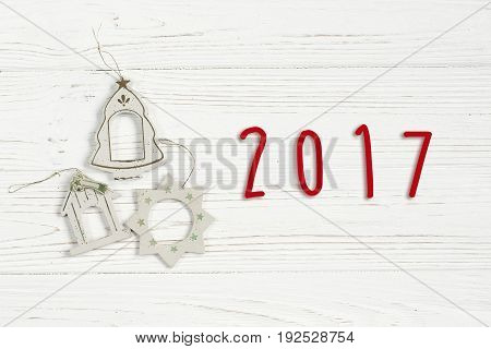 2017 Sign Text On Christmas Simple Vintage Toys On Stylish White Rustic Wooden Background. Space For