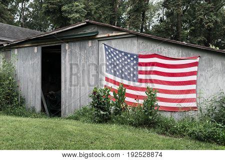 Old American flag on very rustic barn in western virginia
