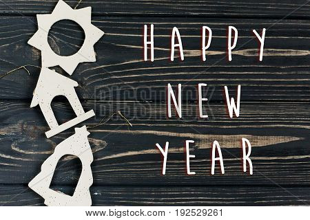 Happy New Year Text Sign On  Simple Christmas Eco Toys On Stylish Black Wooden Background In Border