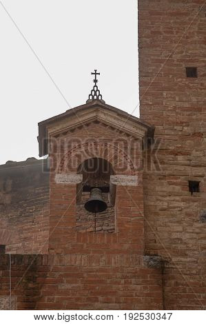 Italy Siena - December 26 2016: the view of the old well with Micat in Vertice motto in the courtyard of the Palazzo Chigi-Saracini on December 26 2016 in Siena Tuscany Italy.