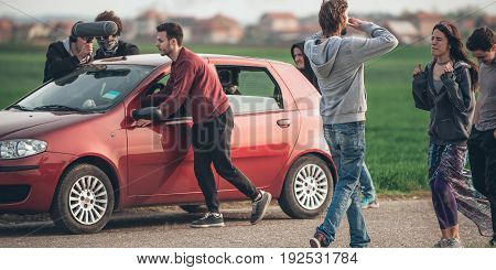 Behind Scene Improvisation. Film Crew Team Pushing Car With Cameraman