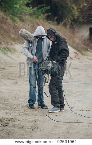 Behind The Scene. Sound Director And Microphone Operator Check Equipment