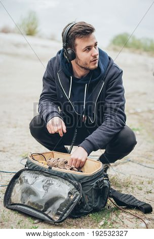 Behind The Scene. Sound Technician Check Equipment Before Recording