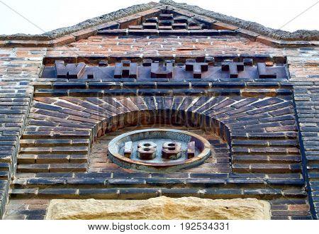 Nineteenth century brick building facade with sky