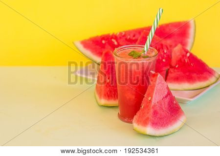Fresh Color Juices Smoothie Fruits Watermelon Bottles On a yellow background