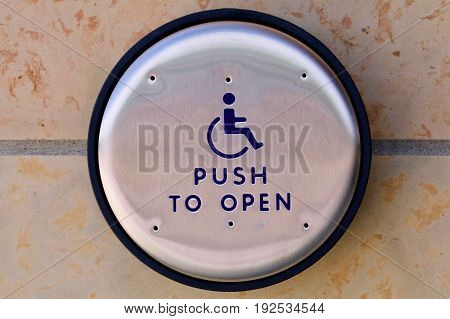 Push to open button for the handicapped