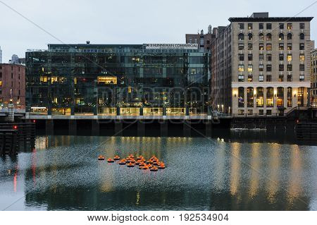 Boston Massachusetts USA - November 17 2016: Artistic piece entitled Safety Orange Swimmers created by Ann Hirsch and Jeremy Angier--floating in Fort Point Channel