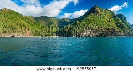 Hanakapiai beach on Na Pali coastline in Kauai from sunset cruise