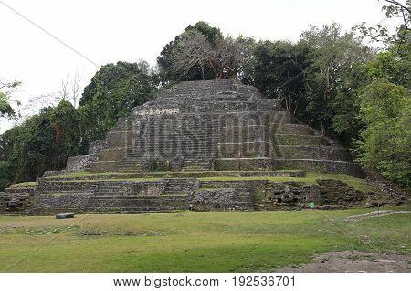 The Jaguar Temple, an ancient Mayan ruin in Lamanai, Belize.