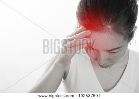 Young woman having strong headache and touch head isolated white background concept of health care lifestyle. focus from top view.
