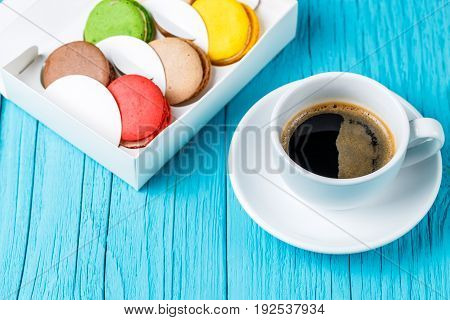 Photo of macaroons cake with cup of coffee