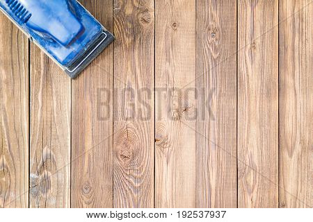 Photo of wooden surface and blue grinder