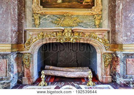 Versailles, France - May 14 2017: Fireplace in the famous Palace of Versailles in France.