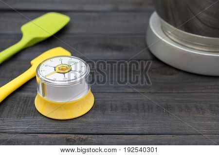 Kitchen Timekeeping And Cooking Tool On Wood Table