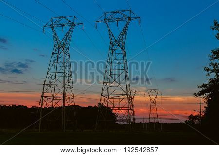 Electricity Cable Communication Towers On Sunset Stretching