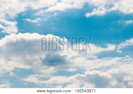 The beautiful endless surface of a sunny sky with clouds
