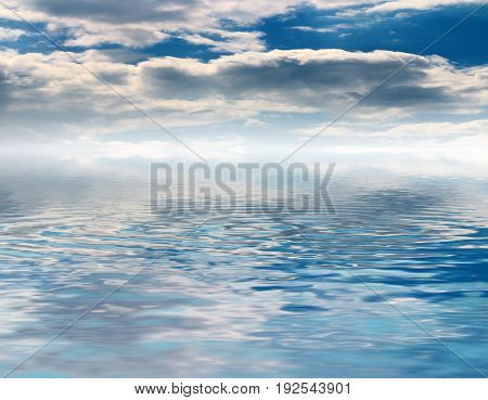 A beautiful sky with clouds over an endless water surface with small waves