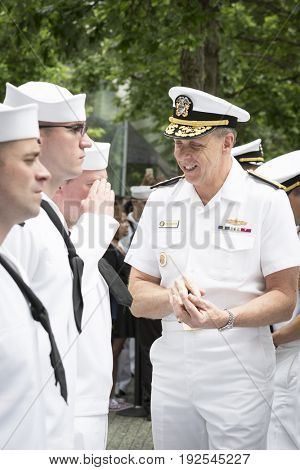 ADM Phil Davidson CDR US Fleet Forces Command gives challenge coins and handshakes to personnel at re-enlistment and promotion ceremony, National Sept 11 Memorial site Fleet Week NEW YORK MAY 26 2017