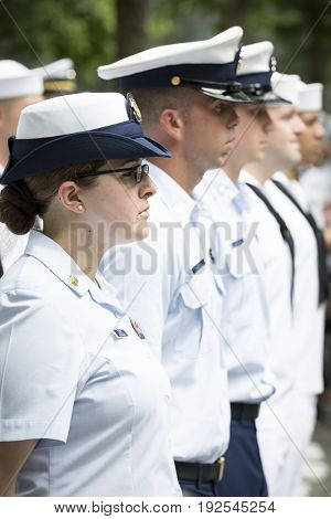 Participating U.S. Coast Guard personnel stand at attention at the re-enlistment and promotion ceremony at the National September 11 Memorial site. Fleet Week, NEW YORK MAY 26 2017