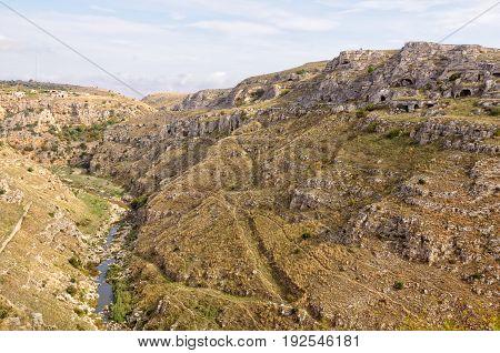 The deep curving gorge of the Gravina di Matera river - Matera Basilicata Italy