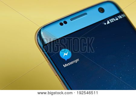 New york, USA - June 23, 2017: Facebook messenger application icon on smartphone screen close-up. Facebook messenger app icon with copy space on screen